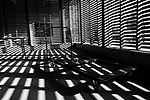 Storage room interior with light patterns creating geometric shapes patterns of light and shadows