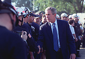 United States President George W. Bush thanks search and rescue personnel at the Pentagon in Washington, DC during a visit in the late afternoon of September 12, 2001.  Bush, accompanied by US Secretary of Defense Donald H. Rumsfeld, National Security Advisor Condoleezza Rice, and Chief of Staff Andrew Card, toured the scene of destruction where hijacked American Airlines Flight 77, a Boeing 757, was purposely crashed into the west side of the world-famous five-sided building.  <br /> Credit: DoD via CNP