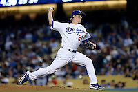 Zack Greinke #21 of the Los Angeles Dodgers pitches against the Atlanta Braves at Dodger Stadium on June 6, 2013 in Los Angeles, California. (Larry Goren/Four Seam Images)