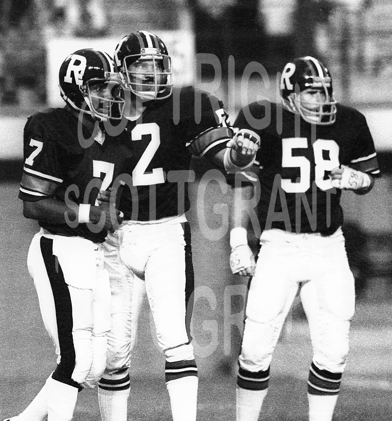 Condredge Holloway Brad Carr Doug McGee Ottawa Rough Riders 1979. Photo F. Scott Grant