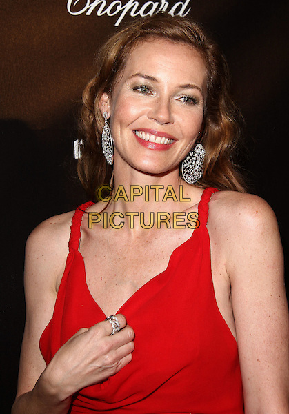 Connie Nielsen.The Weinstein Company 2012 Golden Globe Awards After Party held at  Bar 210 at the Beverly Hilton Hotel, Hollywood, California, USA..January 15th, 2012.globes half length red earrings silver hand ring.CAP/ADM/CH.©Charles Harris/AdMedia/Capital Pictures
