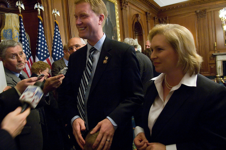 WASHINGTON, DC - April 29: After a photo op version of his swearing in with House Speaker Nancy Pelosi, D-Calif., Rep. Scott Murphy, D-N.Y., talks to media with Sen. Kirsten Gillibrand, D-N.Y., after he was sworn in on the House floor to become the newest member of Congress. Representing New York's 20th district, he replaces former Democratic Rep. Gillibrand, who now serves in the New York Senate seat vacated by Secretary of State Hillary Rodham Clinton. Murphy, a venture capitalist and Missouri native who moved to his wife's hometown of Glens Falls, N.Y., three years ago, told the House after taking the oath of office that he wanted to work with members from both parties. (Photo by Scott J. Ferrell/Congressional Quarterly)