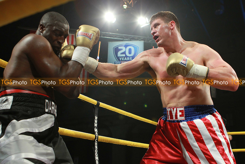 Tye Fields (american flag shorts) beats Michael Sprott (black shorts) on points at Prizefighter International Heavyweights Semi Finals at Alexandra Palace, promoted by Matchroom Sports - 07/05/11 - MANDATORY CREDIT: Chris Royle/TGSPHOTO - Self billing applies where appropriate - 0845 094 6026 - contact@tgsphoto.co.uk - NO UNPAID USE..