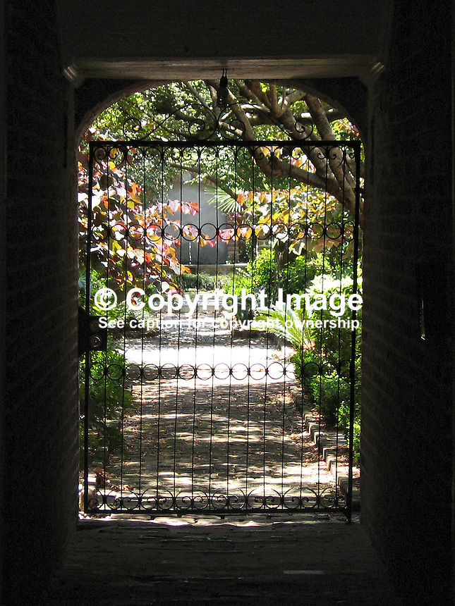 Gateway to garden at rear of typical house in Charleston, South Carolina, USA. 200705140053..Copyright Image from Victor Patterson, 54 Dorchester Park, Belfast, UK, BT9 6RJ..Tel: +44 28 9066 1296.Mob: +44 7802 353836.Voicemail +44 20 8816 7153.Skype: victorpattersonbelfast.Email: victorpatterson@mac.com.Email: victorpatterson@ireland.com (back-up)..IMPORTANT: If you wish to use this image or any other of my images please go to www.victorpatterson.com and click on the Terms & Conditions. Then contact me by email or phone with the reference number(s) of the image(s) concerned.