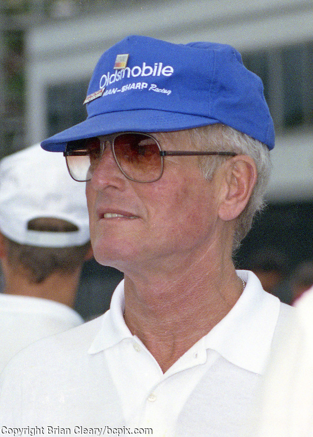 Paul Newman smiles in the pits at the Nissan World Challenge IMSA race, Florida State Fairgrounds, September 1990. (Photo by Brian Cleary/www.bcpix.com)