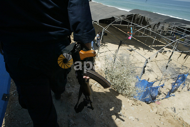 Palestinian security forces inspect damages at a summer camp which was set on fire overnight by masked gunmen in Deir al-Balah center Gaza strip on June 28, 2010. Photo by Ashraf Amra