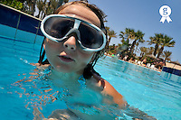Girl with mask in swimming pool, Jerba, Tunisia (Licence this image exclusively with Getty: http://www.gettyimages.com/detail/107813395 )