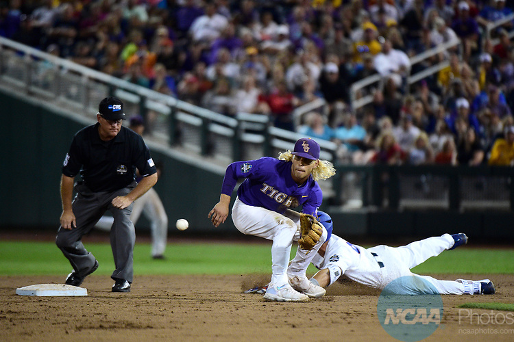 OMAHA, NE - JUNE 27: Kramer Robertson (3) of Louisiana State University catches the ball during game two of the Division I Men's Baseball Championship held at TD Ameritrade Park on June 27, 2017 in Omaha, Nebraska. The University of Florida defeated Louisiana State University 6-1 in game two of the best of three series. (Photo by Corey Solotorovski/NCAA Photos via Getty Images)