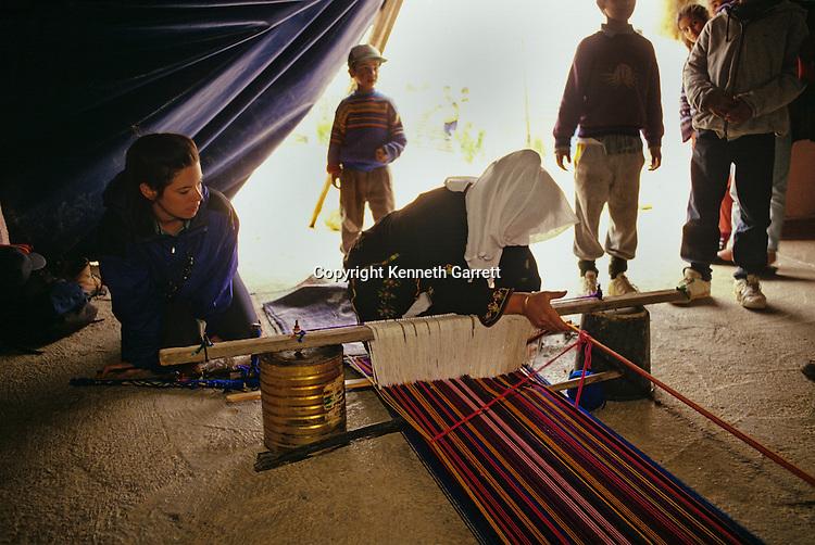 Bedouin woman weaving on ground loom, Jordan