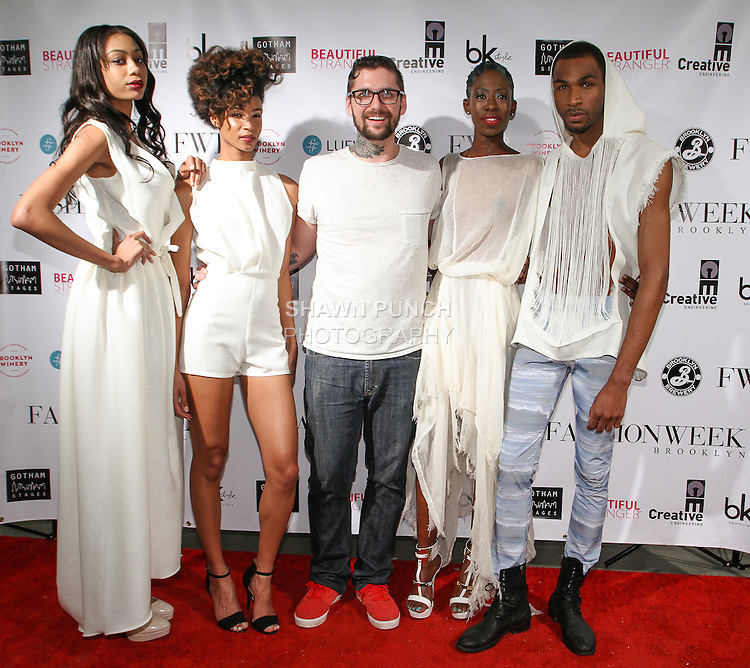 Fashion designer Bradley Jordan poses on red carpet with models after his Bradley Douglas Jordan Spring Summer 2015 collection fashion show, during Fashion Week Brooklyn Spring Summer 2015.