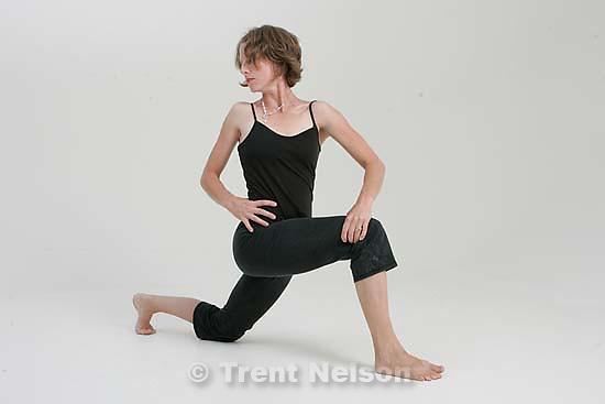 Pat Wickman doing yoga; 7.22.2005<br />