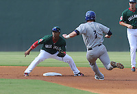 Shortstop Jose Garcia (7) of the Greenville Drive gets ready to tag out Ryan Casteel (7) of the Asheville Toursits, who was attempting to steal second base in a game on Sunday, August 26, 2012, at Fluor Field at the West End in Greenville, South Carolina. Greenville won, 5-4. (Tom Priddy/Four Seam Images)