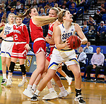 BROOKINGS, SD - FEBRUARY 22: Sydney Stapleton #35 of the South Dakota State Jackrabbits spins with the ball to the basket against the South Dakota Coyotes Saturday at Frost Arena in Brookings, SD. (Photo by Dave Eggen/Inertia)
