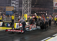 Apr. 5, 2013; Las Vegas, NV, USA: NHRA crew members for top fuel dragster driver Steve Torrence during qualifying for the Summitracing.com Nationals at the Strip at Las Vegas Motor Speedway. Mandatory Credit: Mark J. Rebilas-