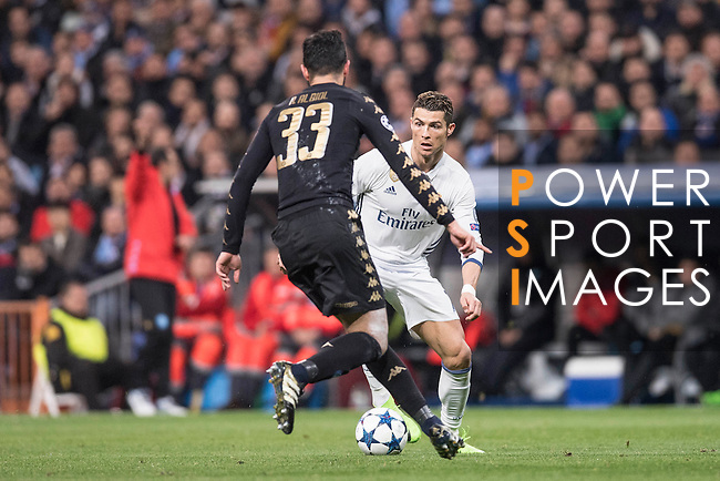 Cristiano Ronaldo of Real Madrid fights for the ball with Raul Albiol of SSC Napoli during the match Real Madrid vs Napoli, part of the 2016-17 UEFA Champions League Round of 16 at the Santiago Bernabeu Stadium on 15 February 2017 in Madrid, Spain. Photo by Diego Gonzalez Souto / Power Sport Images