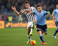 Calcio, Serie A: Lazio vs Juventus. Roma, stadio Olimpico, 4 dicembre 2015.<br /> Juventus&rsquo; Mario Mandzukic, left, and Lazio&rsquo;s Lucas Biglia fight for the ball during the Italian Serie A football match between Lazio and Juventus at Rome's Olympic stadium, 4 December 2015.<br /> UPDATE IMAGES PRESS/Riccardo De Luca