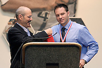 National Soccer Hall of Fame President Will Lunn presents 2004 inductee Eric Wynalda with his medal and jacket during the National Soccer Hall of Fame Induction Ceremony on Monday October 11, 2004 at the National Soccer Hall of Fame and Museum, Oneonta, NY..