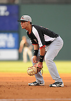 Catcher Jorge Alfaro (11) of the Hickory Crawdads in a game against the Greenville Drive on Friday, August 31, 2012, at Fluor Field at the West End in Greenville, South Carolina. Alfaro is the Texas Rangers' No. 7 prospect, according to Baseball America. Greenville won, 7-2. (Tom Priddy/Four Seam Images)