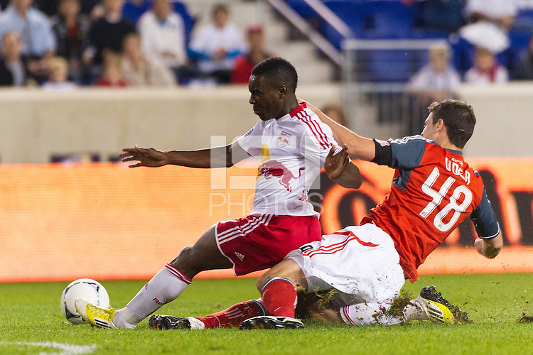 Lloyd Sam (10) of the New York Red Bulls and Darren O'Dea (48) of Toronto FC. The New York Red Bulls defeated Toronto FC 4-1 during a Major League Soccer (MLS) match at Red Bull Arena in Harrison, NJ, on September 29, 2012.