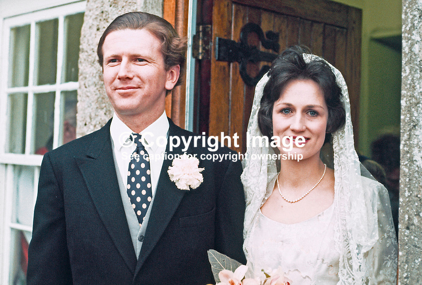 Major Nigel Cowie and his bride, Miss Juliana Brooke, after their wedding in Co Fermanagh, N Ireland, UK, 197303020123g. Juliana is the daughter of Captain John Brooke and Mrs Brooke, and the granddaughter of the 1st Viscount Brookeborough.<br /> <br /> Copyright Image from Victor Patterson, 54 Dorchester Park, <br /> Belfast, UK, BT9 6RJ<br /> <br /> t1: +44 28 9066 1296 (from Rep of Ireland 048 9066 1296)<br /> t2: +44 28 9002 2446 (from Rep of Ireland 048 9002 2446)<br /> m: +44 7802 353836<br /> <br /> e1: victorpatterson@me.com<br /> e2: victorpatterson@gmail.com<br /> <br /> www.victorpatterson.com<br /> <br /> Please see my Terms and Conditions of Use at www.victorpatterson.com. It is IMPORTANT that you familiarise yourself with them.<br /> <br /> Images used on the Internet must be visibly watermarked i.e. &copy; Victor Patterson within the body of the image and copyright metadata must not be deleted. Images used on the Internet have a size restriction of 4kbs and will be chargeable at current NUJ rates unless agreed otherwise.<br /> <br /> This image is only available for the use of the download recipient i.e. television station, newspaper, magazine, book publisher, etc, and must not be passed on to any third party. It is also downloaded on condition that each and every usage is notified within 7 days to victorpatterson@me.com<br /> <br /> The right of Victor Patterson to be identified as the author is asserted in accordance with The Copyright Designs And Patents Act (1988).
