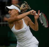 Elena Vesnina (RUS) against Yanina Wickmayer (BEL) in the first round of the Ladies Singles. Vesnina beat Wickmayer 6-1 6-1..Tennis - Wimbledon - Day 1 - Mon 22nd June 2009 - All England Lawn Tennis Club  - Wimbledon - London - United Kingdom..Frey Images, Barry House, 20-22 Worple Road, London, SW19 4DH.Tel - +44 20 8947 0100.Cell - +44 7843 383 012..Tennis - Wimbledon - Day 1 - Monday 22nd June 2009 - All England Lawn Tennis Club  - Wimbledon - London - United Kingdom..Frey Images, Barry House, 20-22 Worple Road, London, SW19 4DH.Tel - +44 20 8947 0100.Cell - +44 7843 383 012