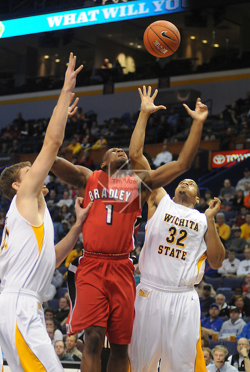 March 4,  2011          From left:  Wichita State Shockers center Garrett Stutz (41), Bradley Braves guard Dodie Dunson (1), and Wichita State Shockers forward Gabe Blair (32) all grab for a rebound in the first half. Wichita State played Bradley University in the third quarterfinal game of the NCAA Missouri Valley Conference Men's Basketball Tournament on Friday March 4, 2011 at the Scottrade Center in downtown St. Louis.