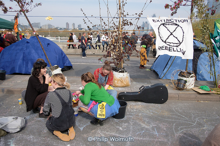 Extinction Rebellion climate change campaigners occupy Waterloo Bridge, London.