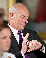 White House Chief of Staff General John Kelly checks his watch after United States President Donald J. Trump made remarks at an event with small businesses in the East Room of the White House in Washington, DC on Tuesday, August 1, 2017. Photo Credit: Ron Sachs/CNP/AdMedia