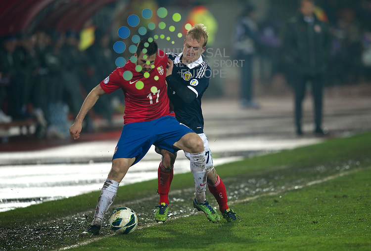 Nenad Tomovic of Serbia  challenges for the ball against Steven Naismith of Scotland during the Fifa World Cup Qualifier between Serbia and Scotland at Stadion Karadorde, Novi Sad, Serbia. 26 March 2013. Picture by Ian Sneddon / Universal News and Sport (Scotland). All pictures must be credited to www.universalnewsandsport.com. (Office) 0844 884 51 22. .