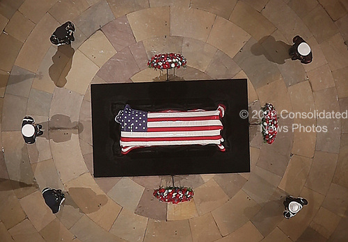 Former President George H. W. Bush lies in state in the U.S. Capitol Rotunda Monday, Dec. 3, 2018, in Washington. (Pool photo by Morry Gash via AP)