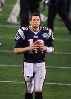 Feb 3, 2008; Glendale, AZ, USA; New England Patriots quarterback (12) Tom Brady against the New York Giants during Super Bowl XLII at the University of Phoenix Stadium.  Mandatory Credit: Mark J. Rebilas-