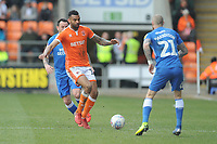Blackpool's Curtis Tilt under pressure from Peterborough United's Marcus Maddison<br /> <br /> Photographer Kevin Barnes/CameraSport<br /> <br /> The EFL Sky Bet League One - Blackpool v Peterborough United - Saturday 13th April 2019 - Bloomfield Road - Blackpool<br /> <br /> World Copyright &copy; 2019 CameraSport. All rights reserved. 43 Linden Ave. Countesthorpe. Leicester. England. LE8 5PG - Tel: +44 (0) 116 277 4147 - admin@camerasport.com - www.camerasport.com