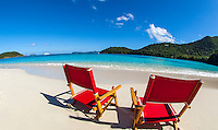 Red beach chairs at Hawksnest Beach<br />