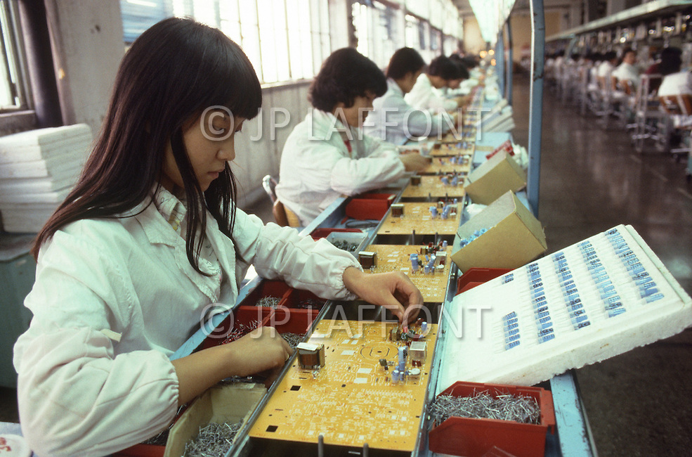 October 1984. In Shaghai, the factory Feyue, which is the factory number 18 for radio and TV in China, workers are manufacturing TV Sets. System PAL, those sets are only made for exportation. Their price are between $420 and $720.