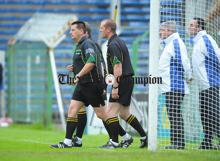Referee Brian Gavin returns after consulting his officials after an incident between Limerick and Clare players during the All-Ireland senior championship qualifier phase 3 game at Semple Stadium. Photograph by John Kelly.