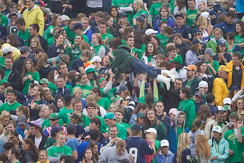 Notre Dame student section celebrates touchdown during NCAA football game between the Notre Dame Fighting Irish and the Michigan Wolverines.  Michigan defeated Notre Dame 28-24 in game at Notre Dame Stadium in South Bend, Indiana.