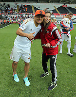 Jefferson Montero of Swansea City with Mariela Nisotaki after the Swansea City FC v Manchester City Premier League game at the Liberty Stadium, Swansea, Wales, UK, Sunday 15 May 2016
