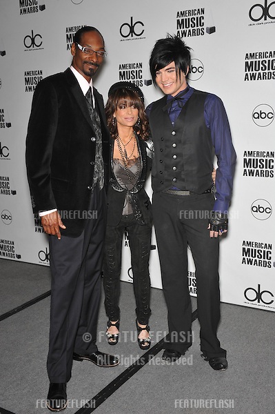 Snoop Dogg (left), Paula Abdul & Adam Lambert at the nominations announcement for the 2009 American Music Awards at the Beverly Hills Hotel..October 13, 2009  Los Angeles, CA.Picture: Paul Smith / Featureflash