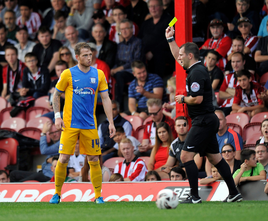 Preston North End's Joe Garner is shown a yellow card by Referee Tim Robinson<br /> <br /> Photographer Ashley Western/CameraSport<br /> <br /> Football - The Football League Sky Bet Championship - Brentford v Preston North End - Saturday 19th September 2015 - Griffin Park - London<br /> <br /> &copy; CameraSport - 43 Linden Ave. Countesthorpe. Leicester. England. LE8 5PG - Tel: +44 (0) 116 277 4147 - admin@camerasport.com - www.camerasport.com