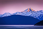 Alpenglow on Chilkat Mountains, Inside Passage near Haines, SE Alaska in early summer.