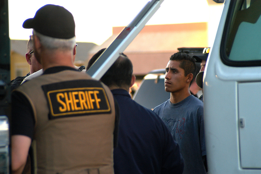 AJ Alexander - An Illegal Immigrant awaits to be processed at one of Sheriff Joe Arpaio's Criminal Sweeps in Phoenix, Arizona..Photo by AJ Alexander