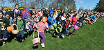 Kids are off and running for the 67th annual Vernon Easter egg hunt, Friday, April 6, 2012, at Henry Park in Vernon, as  thousands of foiled wrapped chocolate Easter eggs covered the ball field for kids to collect. (Jim Michaud/Journal Inquirer).