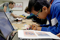 NWA Democrat-Gazette/DAVID GOTTSCHALK  Luu Adler works Monday, March 19, 2018 in the Nerdies Spring Break Session Build a Modbot Robot at the NWA Fab Lab in Fayetteville. The three day camp for students ages 9-15 is a partnership between the New Design School and NWA Fab Lab. The students will build, wire, program and then bring the modbot robots home. The students also learned the essentials of soldering and Arduino Programming.