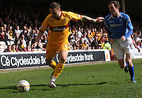 Tom Hateley gets the better of David Robertson in the Motherwell v St Johnstone Clydesdale Bank Scottish Premier League match played at Fir Park, Motherwell on 28.4.12.