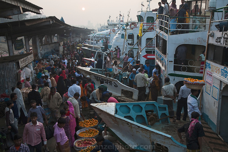 Vendors sell fruits and vegetables to travellers at the Sadarghat dock on the Buriganga River in Dhaka, Bangladesh. The river acts as both a highway and a sewer, with 80 percent of the city's raw sewage draining into it from different parts of the city.