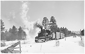 Leased D&amp;RGW #464 with a short RGS freight of two fish-belly flatcars and caboose #0404 just west of Fort Lewis.  The flatcars are rigged for carrying automobiles.<br /> RGS  Fort Lewis, CO  Taken by Richardson, Robert W. - 12/17/1951