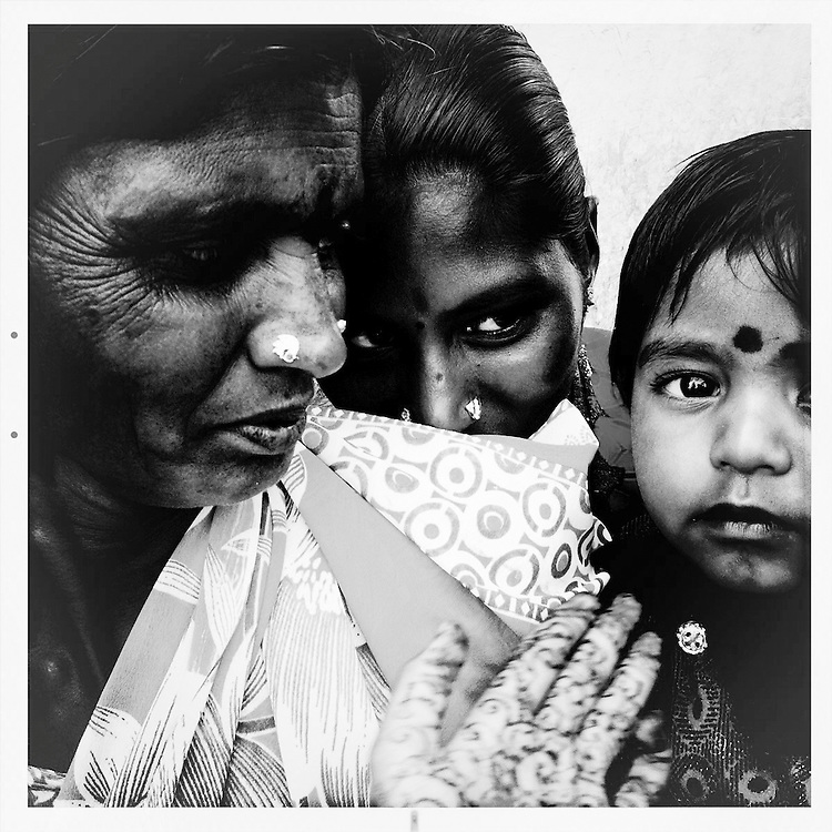 Indian family at the Hampi Temple, in Karnataka state, India.