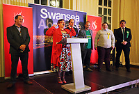 Pictured: Labour candidate for Swansea East constituency Carolyn Harris (2nd L) gives a speech after her win is announced.  Friday 09 June 2017<br />