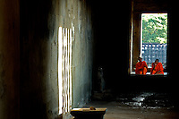 Buddhist Monks, in the temple corridor of Angkor Wat, Siam reap, Cambodia