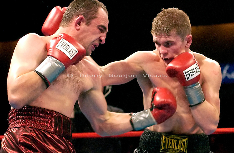 Yuri Foreman (r) in the ring against Andre Trunov during their Junior Middleweight fight at the Mohegan Sun Casino in Uncasville, CT  on 01.10.03. Foreman won by Unanimous Decision..